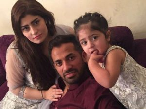 Wahab Riaz with his wife and baby